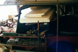 48 Willys side veiw buried in Dads shop
